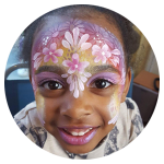 Face painting on girl of flowers